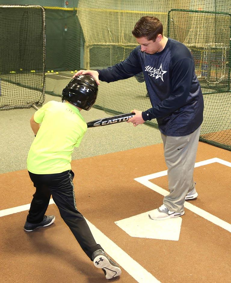 Anthony instructing kid on swing