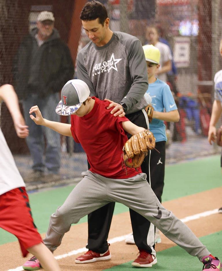 Brian instructing kid Baseball stance