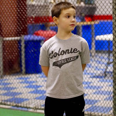 Boy standing in fenced in area