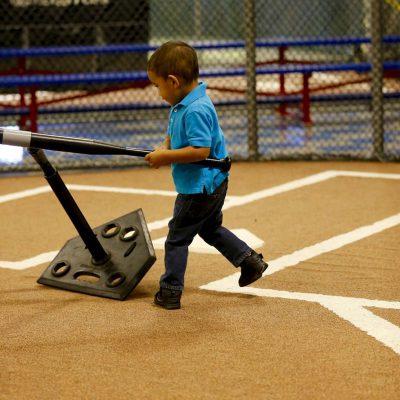 Boy hitting tee-ball