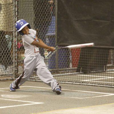 Kid up to bat mid-swing