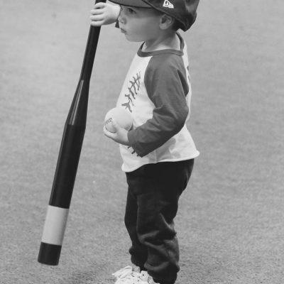 Small child holding a bat